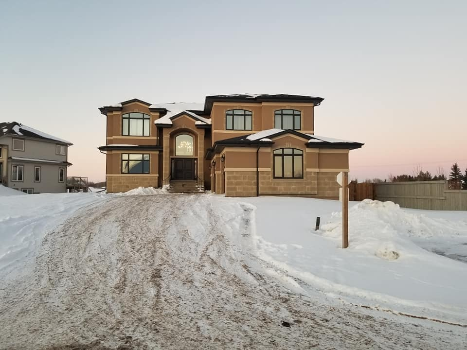 residential stucco house in stony plain